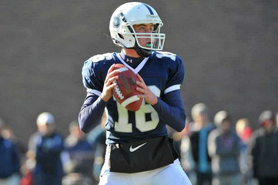 Staples quarterback Jack Massie prepares to throw against Greenwich Nov. 24. Massie and the second-seeded Wreckers will take on Newtown Saturday Dec. 3 in the Class LL semifinals at Bunnell. Photo: RONALD W. HINER, Ron Hiner/For The Westport News / (C) 2011  RONALD W. HINER   (203) 858-6611 ALL RIGHTS RESERVED