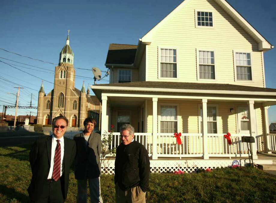From left; Nicholas Calace, executive director of the Bridgeport Housing Authority, Robbi Dunn-Horris, relocation specialist, and Marvin Farbman, former executive director of Connecticut Legal Services, on the site of the former Father Panik Village housing project on Bridgeport's East Side on Thursday, December 1, 2011. Photo: Brian A. Pounds / Connecticut Post