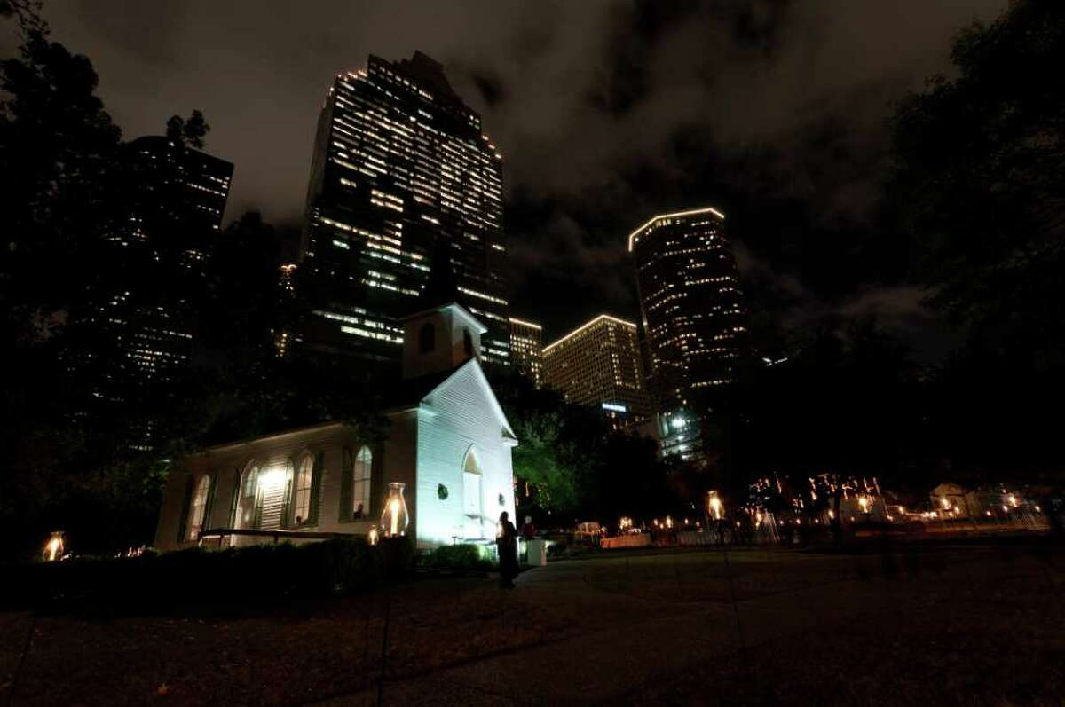 Sam Houston Park is the scene for the Heritage Society's annual holiday Candlelight Tour.