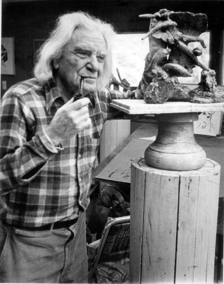 In a 1980 file photo Reuben Nakian is shown at his North Stamford studio considering one of his many miniatures. Nakian died at Stamford Hospital on Dec. 4, 1986. Photo: File Photo