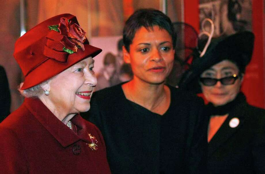 Britain's Queen Elizabeth II, left, with Yoko Ono, right, during her visit to the Museum of Liverpool in Liverpool, England, Thursday, Dec. 1, 2011.  With 8,000 meters of public space, the recently opened museum looks at Britain and the world through the eyes of Liverpool, with 6,000 objects showcasing the city's unique contribution to the world. Woman at center is unidentified. (AP Photo/Tim Hales-Pool) Photo: Tim Hales / AP POOL
