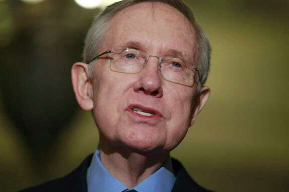Senate Majority Leader Harry Reid of Nev. speaks to reporters about extending the payroll tax cut, Thursday, Dec. 1, 2011, on Capitol Hill in Washington. (AP Photo/Charles Dharapak)
