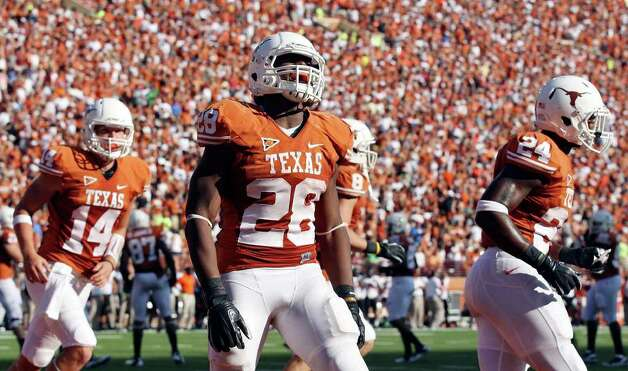 Texas' Malcolm Brown reacts after scoring a touchdown against Oklahoma State during second half action Saturday Oct. 15, 2011 at Texas Memorial Stadium in Austin, Tx. Oklahoma State won 38-26. Photo: EDWARD A. ORNELAS, SAN ANTONIO EXPRESS-NEWS / © SAN ANTONIO EXPRESS-NEWS (NFS)