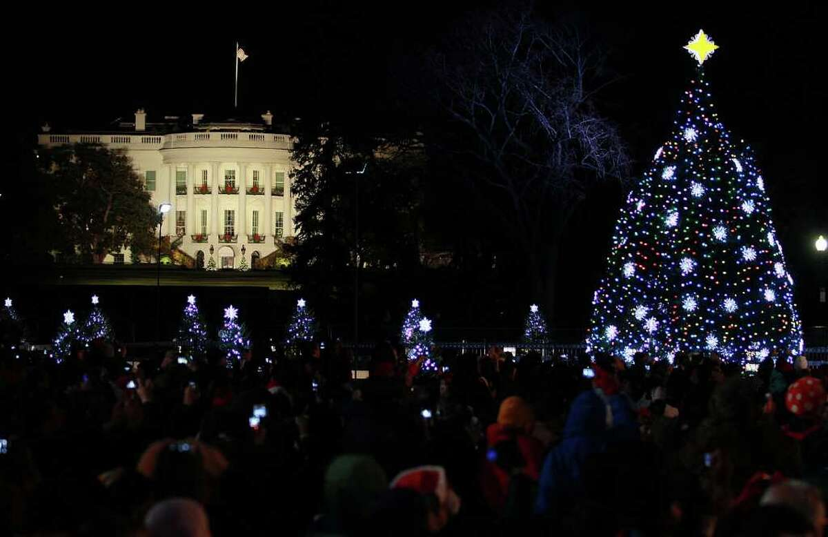 WASHINGTON, DC - DECEMBER 01: The White House is seen in the background after the National Christmas Tree was lit during its lighting ceremony, on December 1, 2011 at the Ellipse, south of the White House, in Washington, DC. The first family participated in the 89th annual National Christmas Tree Lighting Ceremony.