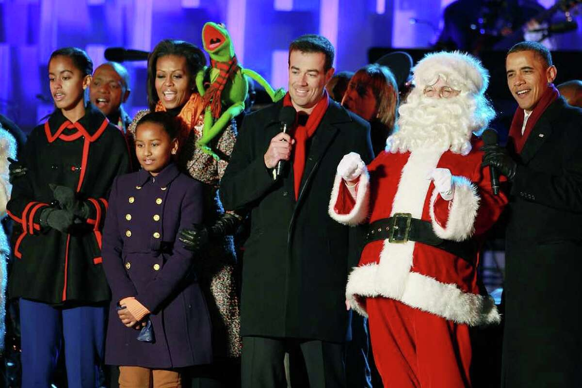 WASHINGTON, DC - DECEMBER 01: President Barack Obama (R), Santa Clause (2nd-R), Carson Daly (C), Kermit the Frog, first lady Michelle Obama, and daughters, Sasha and Malia, sing a song during the National Christmas Tree light ceremony on December 1, 2011 at the Ellipse, south of the White House, in Washington, DC. The first family participated in the 89th annual National Christmas Tree Lighting Ceremony.