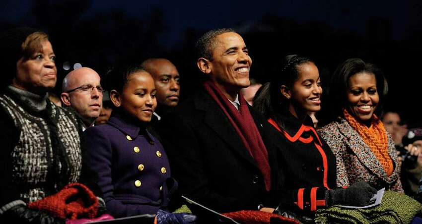 WASHINGTON, DC - DECEMBER 01: (AFP OUT) U.S. President Barack Obama (C) and daughters Sasha (2nd L), Malia (2nd R) along with Marian Robinson (L) and first lady Michelle Obama (R) participate in the 2011 National Christmas Tree Lighting on December 1, 2011 at the Ellipse, south of the White House, in Washington, DC. The first family participated in the 89th annual National Christmas Tree Lighting Ceremony. (Photo by Roger L. Wollenberg-Pool/Getty Images)