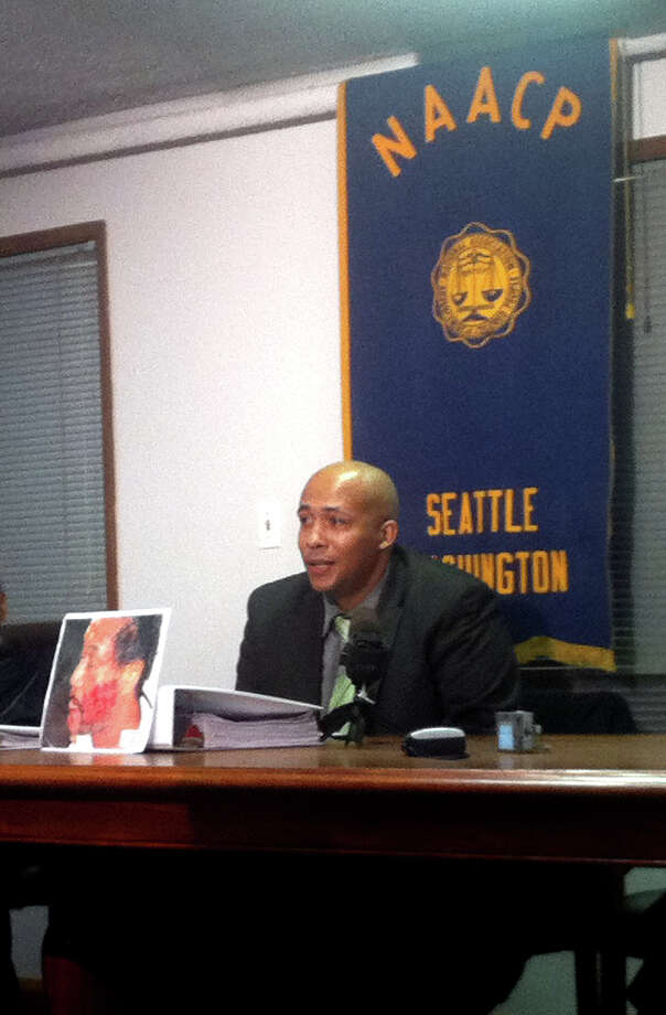 James Bible, president of the Seattle King County NAACP, speaks to reporters Thursday behind a 2010 picture of Terry Jefferson. Photo: Casey McNerthney/seattlepi.com