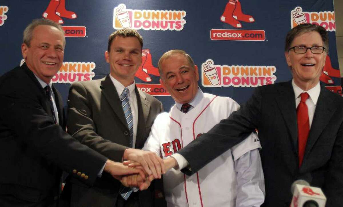 BOSTON, MA - DECEMBER 01: Team owners Larry Lucchino, left, and John Henry, far right, and vice president and general manager Ben Cherington, center, pose with Bobby Valentine after he was introduced as the new manager for the Boston Red Sox during a press conference on December 1, 2011 at Fenway Park in Boston, Massachusetts. (Photo by Elsa/Getty Images)