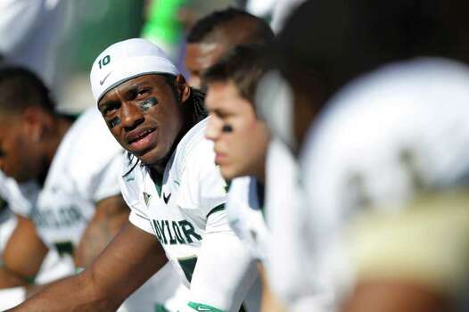 MANHATTAN, KS - OCTOBER 1: Robert Griffin III #10 of the Baylor Bears looks on against the Kansas State Wildcats during the first half of their game at Bill Snyder Family Football Stadium on October 1, 2011 in Manhattan, Kansas. Photo: Joe Robbins, Getty Images / 2011 Getty Images