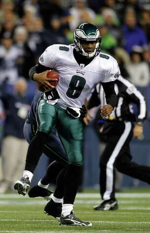 SEATTLE - DECEMBER 01:  Quarterback Vince Young #8 of the Philadelphia Eagles eludes a tackle by Chris Clemons #91 of the Seattle Seahawks on December 1, 2011 at CenturyLink Field in Seattle, Washington.  (Photo by Jonathan Ferrey/Getty Images) Photo: Jonathan Ferrey