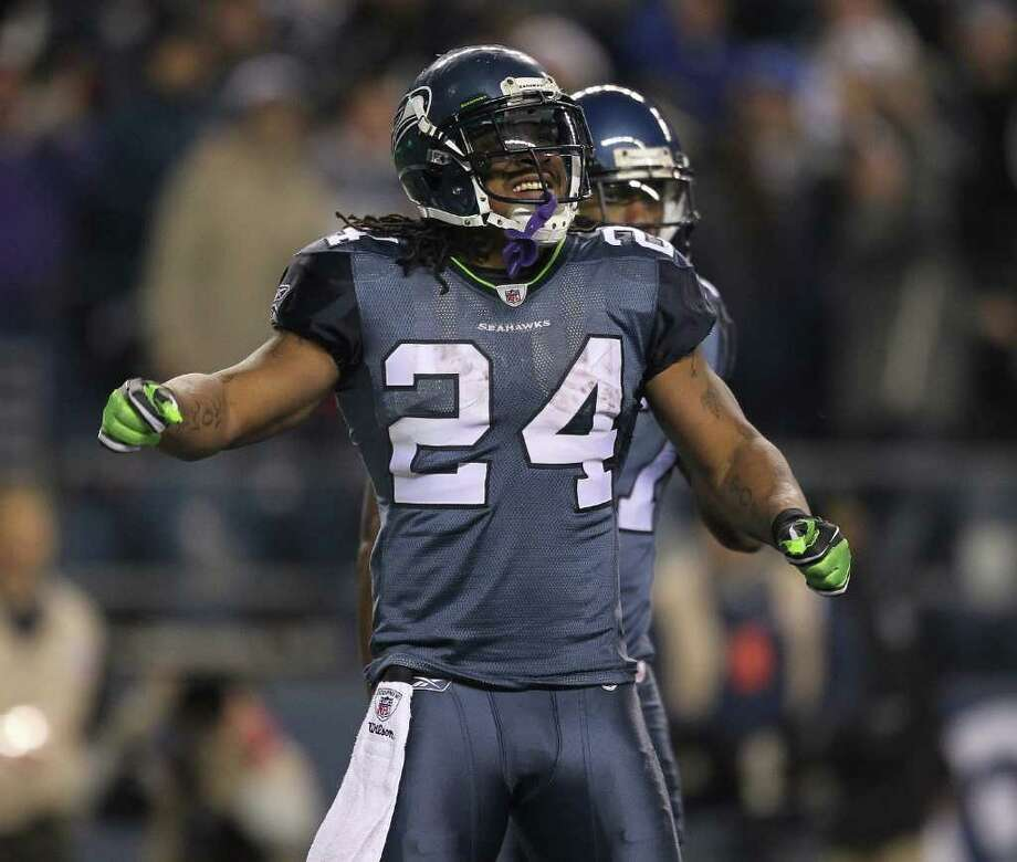 SEATTLE - DECEMBER 01:  Running back Marshawn Lynch #24 of the Seattle Seahawks reacts after rushing for a touchdown against the Philadelphia Eagles at CenturyLink Field on December 1, 2011 in Seattle, Washington. Photo: Otto Greule Jr, Getty Images / 2011 Getty Images