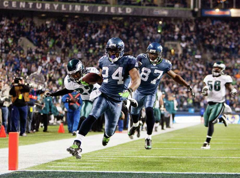SEATTLE, WA - DECEMBER 1:  Seattle Seahawks Marshawn Lynch #24 scores as he out runs Philadelphia Eagles Asante Samuel #22 at CenturyLink Field December 1, 2011 in Seattle, Washington. Photo: Jay Drowns, Getty Images / 2011 Getty Images