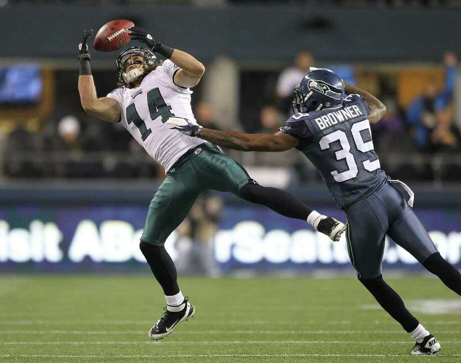 SEATTLE - DECEMBER 01:  Wide receiver Riley Cooper #14 of the Philadelphia Eagles misses this pass against Brandon Browner #39 of the Seattle Seahawks at CenturyLink Field on December 1, 2011 in Seattle, Washington. Photo: Otto Greule Jr, Getty Images / 2011 Getty Images