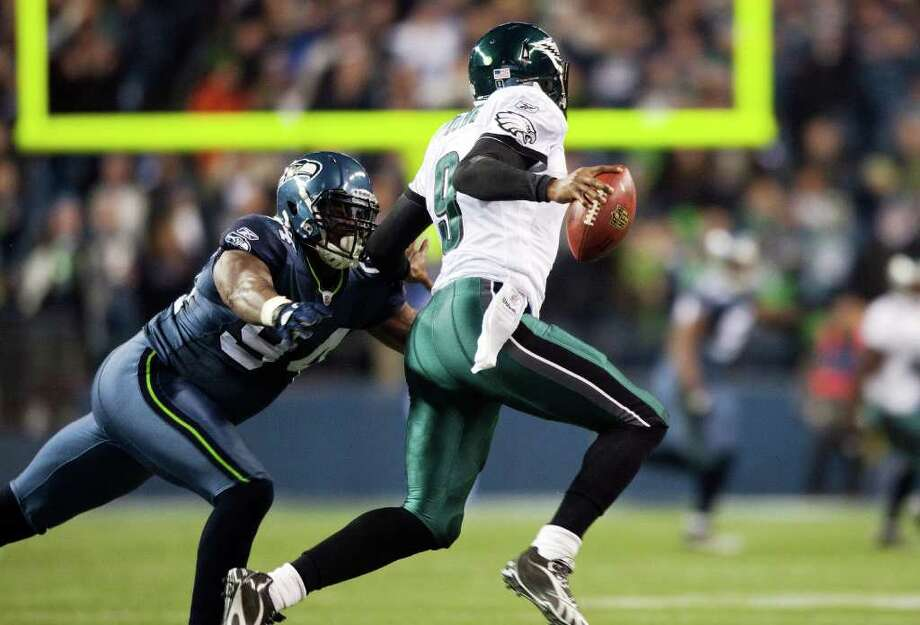 SEATTLE, WA - DECEMBER 1:  Philadelphia Eagles Vince Young #9 is sacked by Anthony Hargrove #94 of the Seattle Seahawks at CenturyLink Field December 1, 2011 in Seattle, Washington. Photo: Jay Drowns, Getty Images / 2011 Getty Images