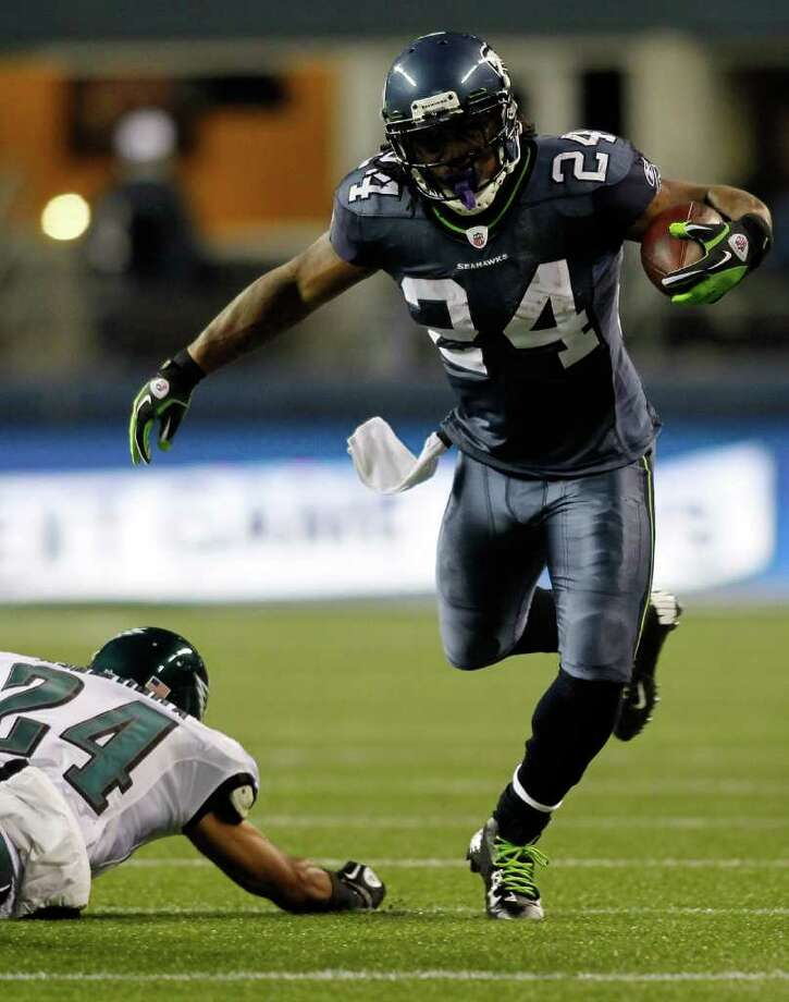 SEATTLE - DECEMBER 01:  Marshawn Lynch #24 of the Seattle Seahawks runs with the ball against Nnamdi Asomugha #24 of the Philadelphia Eagles on December 1, 2011 at CenturyLink Field in Seattle, Washington. Photo: Jonathan Ferrey, Getty Images / 2011 Getty Images