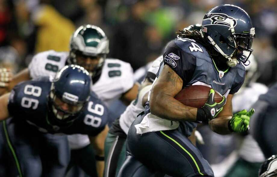 SEATTLE - DECEMBER 01:  Marshawn Lynch #24 of the Seattle Seahawks runs with the ball against the Philadelphia Eagles on December 1, 2011 at CenturyLink Field in Seattle, Washington. Photo: Jonathan Ferrey, Getty Images / 2011 Getty Images