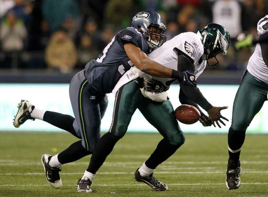 SEATTLE - DECEMBER 01:  Quarterback Vince Young #9 of the Philadelphia Eagles is sacked by K. J. Wright #50 of the Seattle Seahawks on December 1, 2011 at CenturyLink Field in Seattle, Washington. Photo: Jonathan Ferrey, Getty Images / 2011 Getty Images
