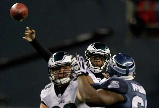 SEATTLE - DECEMBER 01:  Quarterback Vince Young #9 of the Philadelphia Eagles throws a pass against the Seattle Seahawks on December 1, 2011 at CenturyLink Field in Seattle, Washington. Photo: Jonathan Ferrey, Getty Images / 2011 Getty Images