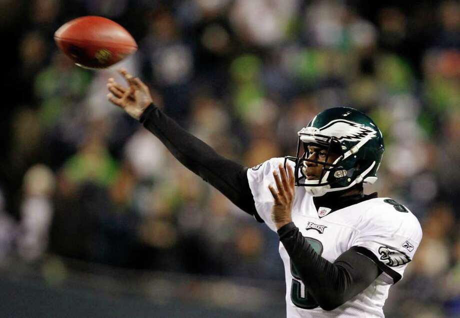 Philadelphia Eagles quarterback Vince Young throws a pass against the Seattle Seahawks in the second half of an NFL football game Thursday, Dec. 1, 2011, in Seattle. The Seahawks won 31-14. Photo: Elaine Thompson