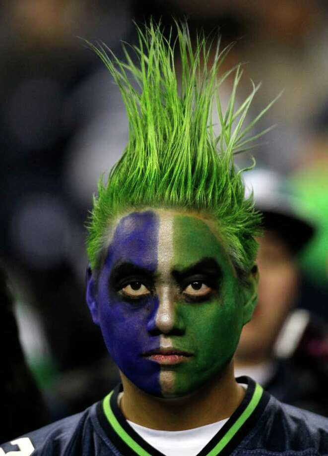 SEATTLE - DECEMBER 01:  A fan of the Seattle Seahawks watches the game against the Philadelphia Eagles on December 1, 2011 at CenturyLink Field in Seattle, Washington. Photo: Jonathan Ferrey, Getty Images / 2011 Getty Images