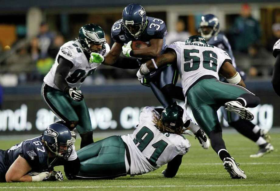SEATTLE - DECEMBER 01: Leon Washington #33 of the Seattle Seahawks is hit by Akeem Jordan #56 of the Philadelphia Eagles on December 1, 2011 at CenturyLink Field in Seattle, Washington. Photo: Jonathan Ferrey, Getty Images / 2011 Getty Images