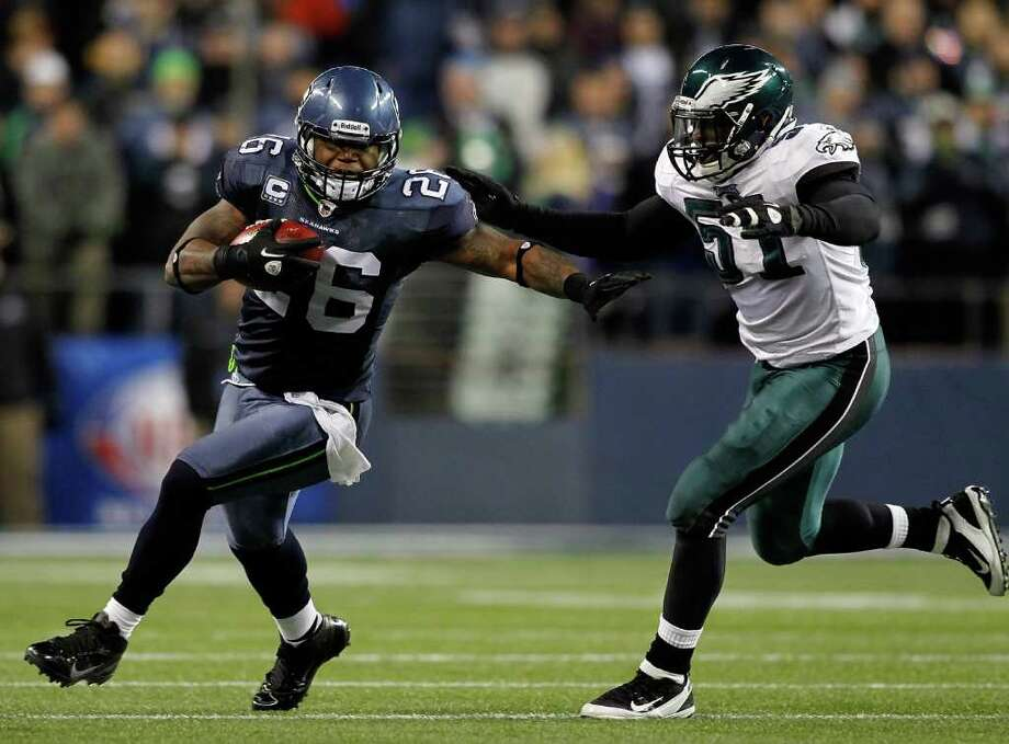SEATTLE - DECEMBER 01:  Michael Robinson #26 of the Seattle Seahawks runs against Jamar Cheney #51 of the Philadelphia Eagles on December 1, 2011 at CenturyLink Field in Seattle, Washington. Photo: Jonathan Ferrey, Getty Images / 2011 Getty Images