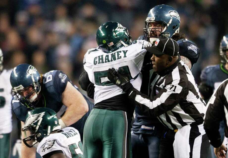 SEATTLE, WA - DECEMBER 1:  Jamar Chaney #51 of the Philadelphia Eagles fights with Robert Gallery #72 of the Seattle Seahawks as umpire Ruben Fowler tries to separate them at CenturyLink Field December 1, 2011 in Seattle, Washington. Seattle won 34-14. Photo: Jay Drowns, Getty Images / 2011 Getty Images