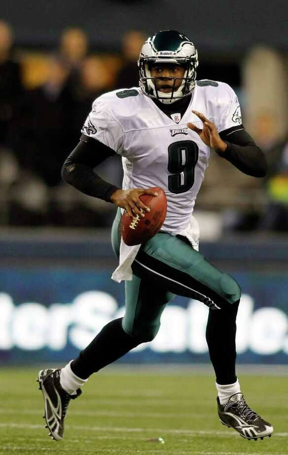 SEATTLE - DECEMBER 01:  Quarterback Vince Young #9 of the Philadelphia Eagles scrambles out of the pocket against the Seattle Seahawks on December 1, 2011 at CenturyLink Field in Seattle, Washington. Photo: Jonathan Ferrey, Getty Images / 2011 Getty Images