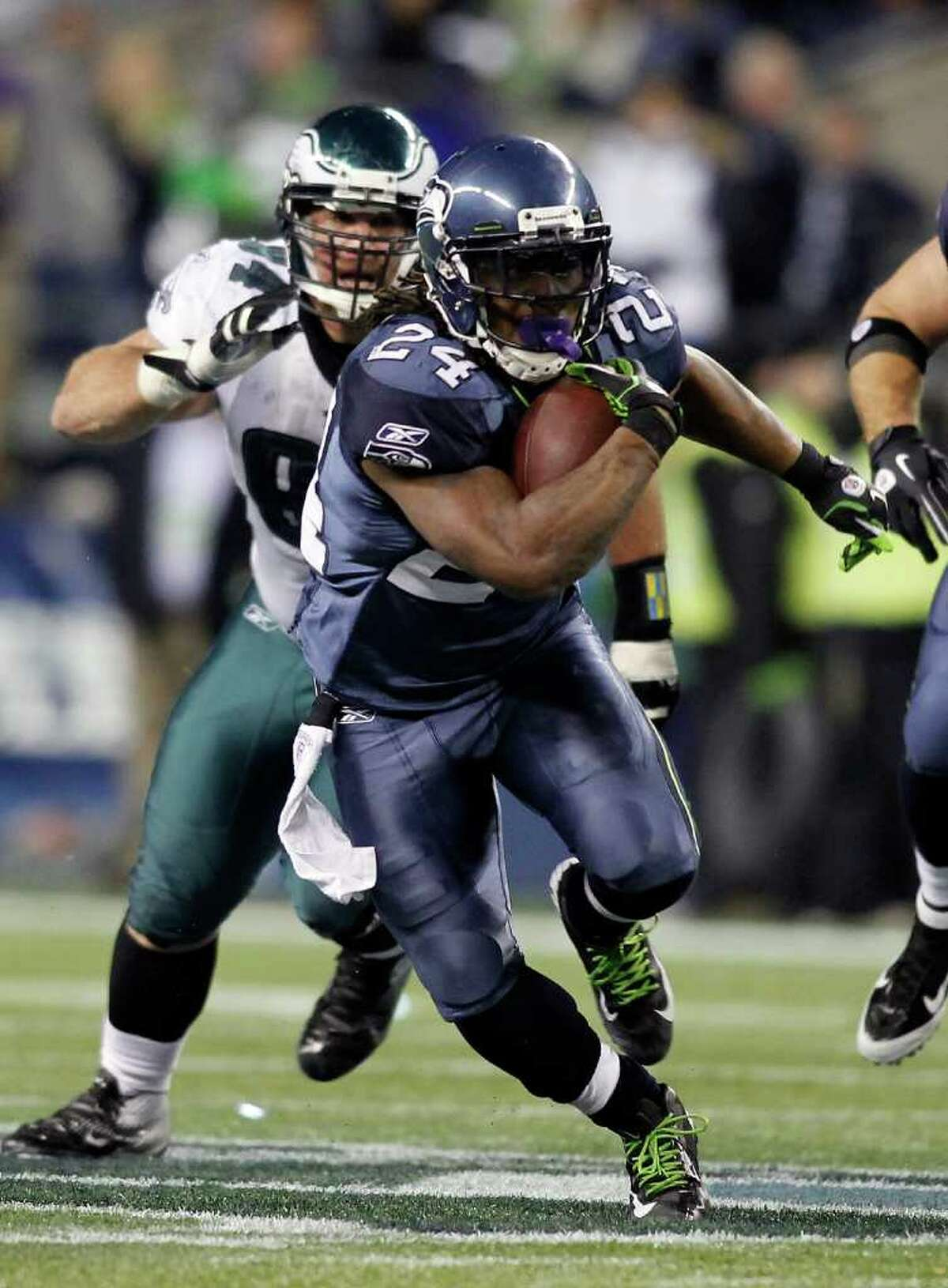 SEATTLE - DECEMBER 01: Marshawn Lynch #24 of the Seattle Seahawks runs with the ball against the Philadelphia Eagles defense on December 1, 2011 at CenturyLink Field in Seattle, Washington.