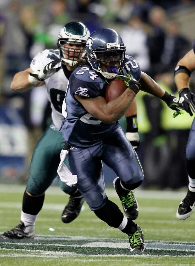 SEATTLE - DECEMBER 01:  Marshawn Lynch #24 of the Seattle Seahawks runs with the ball against the Philadelphia Eagles defense on December 1, 2011 at CenturyLink Field in Seattle, Washington. Photo: Jonathan Ferrey, Getty Images / 2011 Getty Images