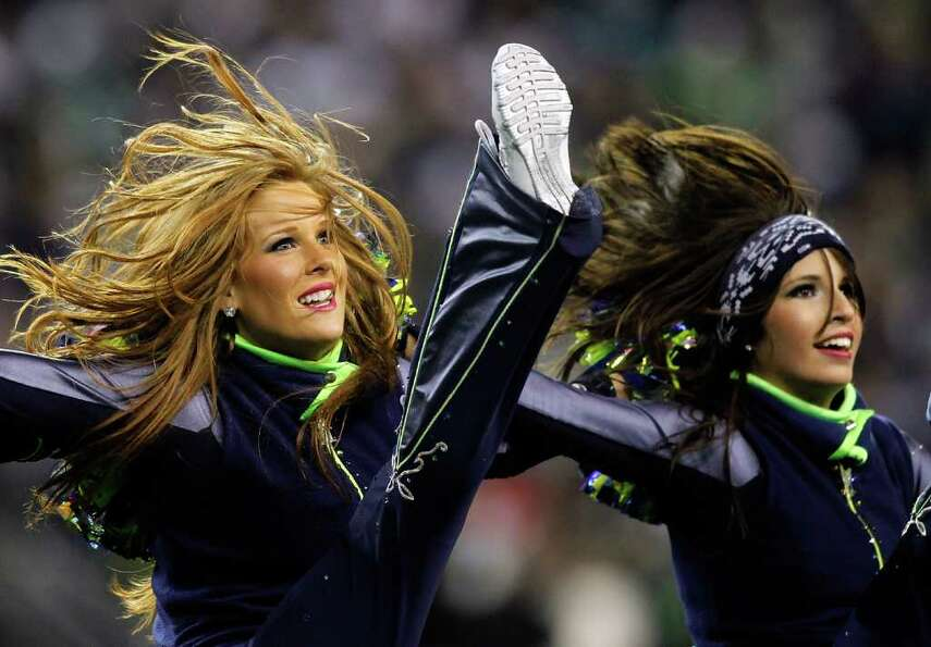 SEATTLE - DECEMBER 01:  Cheerleaders of the Seattle Seahawks perform during the game against the Phi