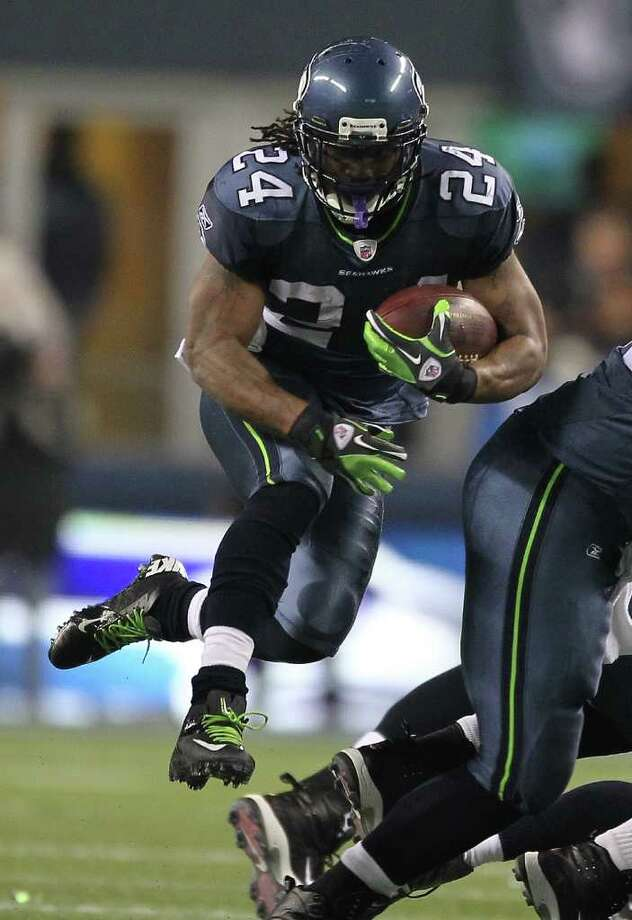 SEATTLE - DECEMBER 01:  Running back Marshawn Lynch #24 of the Seattle Seahawks rushes against the Philadelphia Eagles at CenturyLink Field on December 1, 2011 in Seattle, Washington. The Seahawks defeated the Eagles 31-14. Photo: Otto Greule Jr, Getty Images / 2011 Getty Images