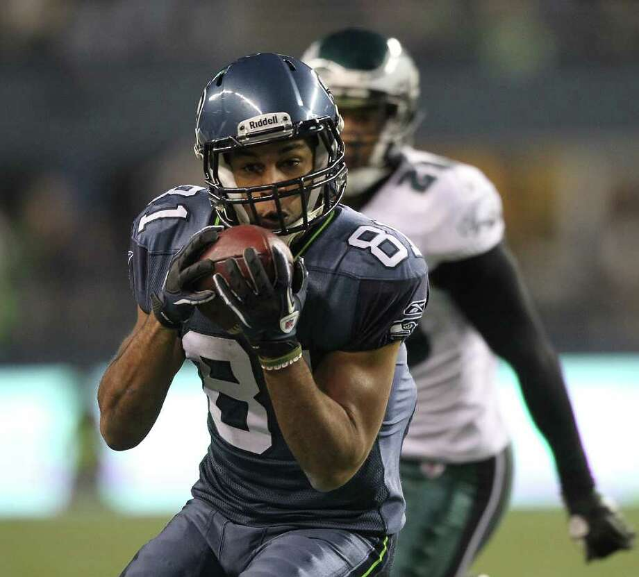 SEATTLE - DECEMBER 01:  Wide receiver Golden Tate #81 of the Seattle Seahawks makes a catch against Nate Allen #29 of the Philadelphia Eagles at CenturyLink Field on December 1, 2011 in Seattle, Washington. The Seahawks defeated the Eagles 31-14. Photo: Otto Greule Jr, Getty Images / 2011 Getty Images