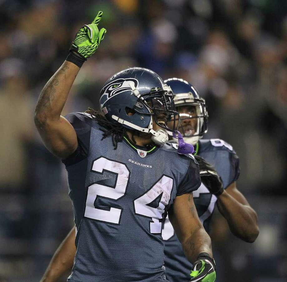 SEATTLE - DECEMBER 01:  Running back Marshawn Lynch #24 of the Seattle Seahawks celebrates with Ben Obomanu #87 after scoring the second touchdown against the Philadelphia Eagles at CenturyLink Field on December 1, 2011 in Seattle, Washington. The Seahawks defeated the Eagles 31-14. Photo: Otto Greule Jr, Getty Images / 2011 Getty Images