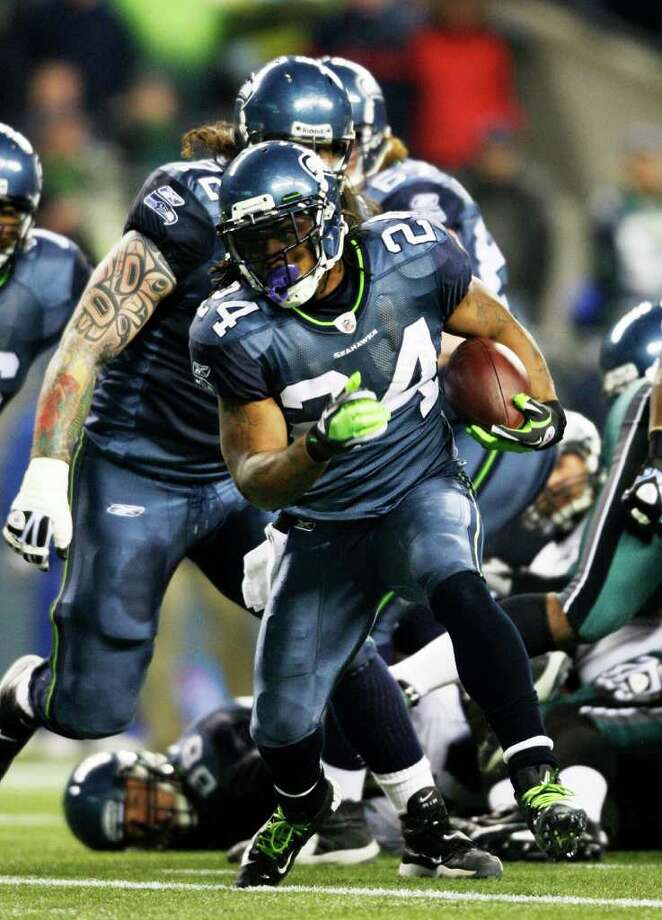 SEATTLE, WA - DECEMBER 1:  Marshawn Lynch #24 of the Seattle Seahawks runs for a score against the Philadelphia Eagles at CenturyLink Field December 1, 2011 in Seattle, Washington. Photo: Jay Drowns, Getty Images / 2011 Getty Images