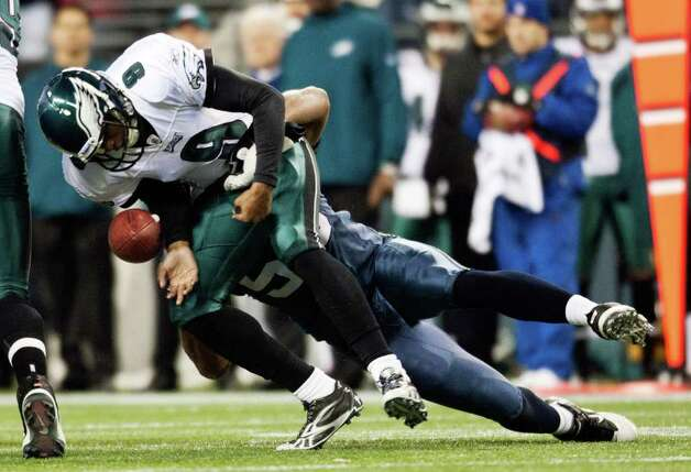 SEATTLE, WA - DECEMBER 1:  Vince Young #9 of the Philadelphia Eagles is sacked by K.J. Wright #50 of the Seattle Seahawks at CenturyLink Field December 1, 2011 in Seattle, Washington. Seattle won 34-14. Photo: Jay Drowns, Getty Images / 2011 Getty Images