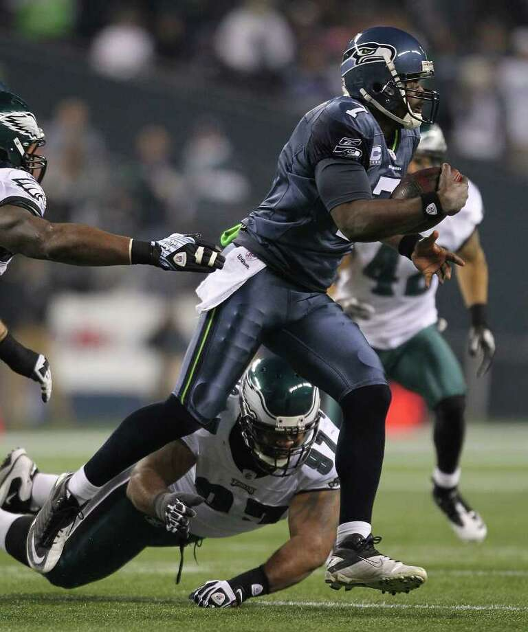 SEATTLE - DECEMBER 01:  Quarterback Tarvaris Jackson #7 of the Seattle Seahawks scrambles against Cullen Jenkins #97 of the Philadelphia Eagles at CenturyLink Field on December 1, 2011 in Seattle, Washington. The Seahawks defeated the Eagles 31-14. Photo: Otto Greule Jr, Getty Images / 2011 Getty Images