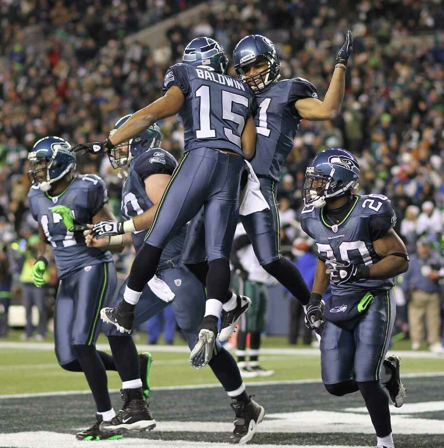 SEATTLE - DECEMBER 01:  Wide receiver Golden Tate #81 of the Seattle Seahawks celebrates with Doug Baldwin #15 after scoring a touchdown against the Philadelphia Eagles at CenturyLink Field on December 1, 2011 in Seattle, Washington. The Seahawks defeated the Eagles 31-14. Photo: Otto Greule Jr, Getty Images / 2011 Getty Images