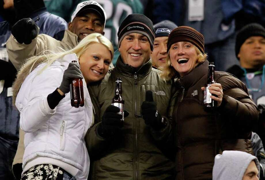 SEATTLE - DECEMBER 01:  Fans cheers during the Seattle Seahawks game against the Philadelphia Eagles on December 1, 2011 at CenturyLink Field in Seattle, Washington. Photo: Jonathan Ferrey, Getty Images / 2011 Getty Images