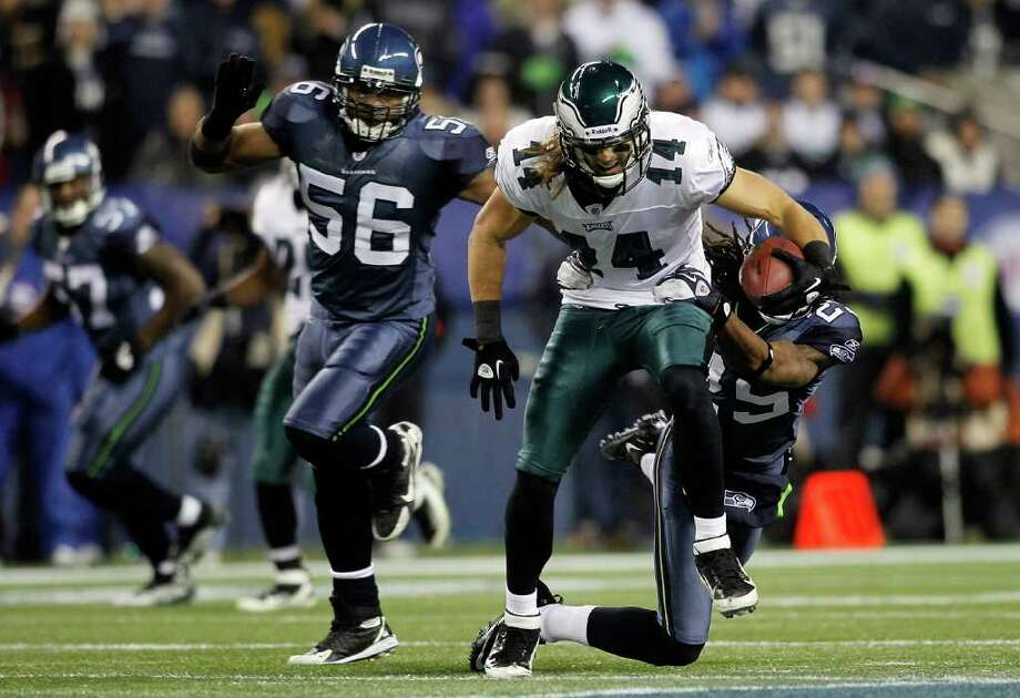 SEATTLE - DECEMBER 01:  Riley Cooper #14 of the Philadelphia Eagles makes a catch against Richard Sherman #25 and LeRoy Hill #56 of the Seattle Seahawks on December 1, 2011 at CenturyLink Field in Seattle, Washington. Photo: Jonathan Ferrey, Getty Images / 2011 Getty Images