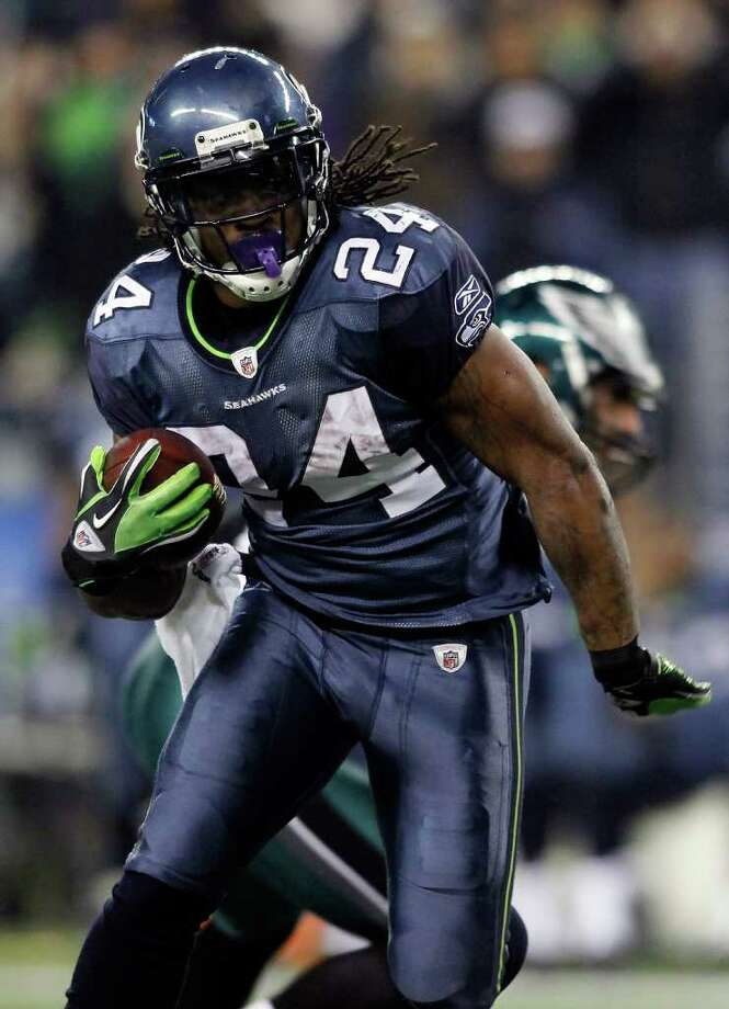 SEATTLE - DECEMBER 01:  Marshawn Lynch #24 of the Seattle Seahawks runs for a touchdown in the 2nd quarter against the Philadelphia Eagles on December 1, 2011 at CenturyLink Field in Seattle, Washington. Photo: Jonathan Ferrey, Getty Images / 2011 Getty Images