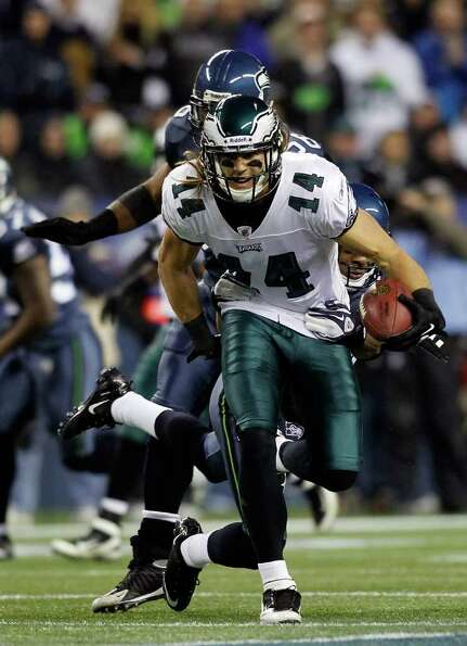 SEATTLE - DECEMBER 01:  Riley Cooper #14 of the Philadelphia Eagles makes a catch against Richard Sh