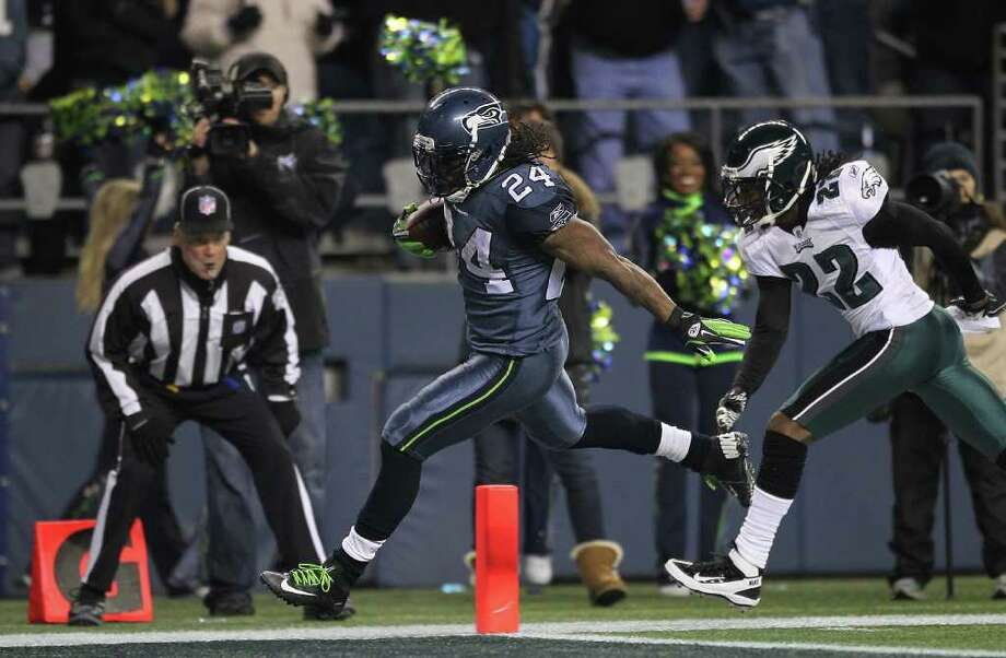SEATTLE - DECEMBER 01:  Running back Marshawn Lynch #24 of the Seattle Seahawks rushes for a touchdown against Asante Samuel #22 of the Philadelphia Eagles at CenturyLink Field on December 1, 2011 in Seattle, Washington. Photo: Otto Greule Jr, Getty Images / 2011 Getty Images