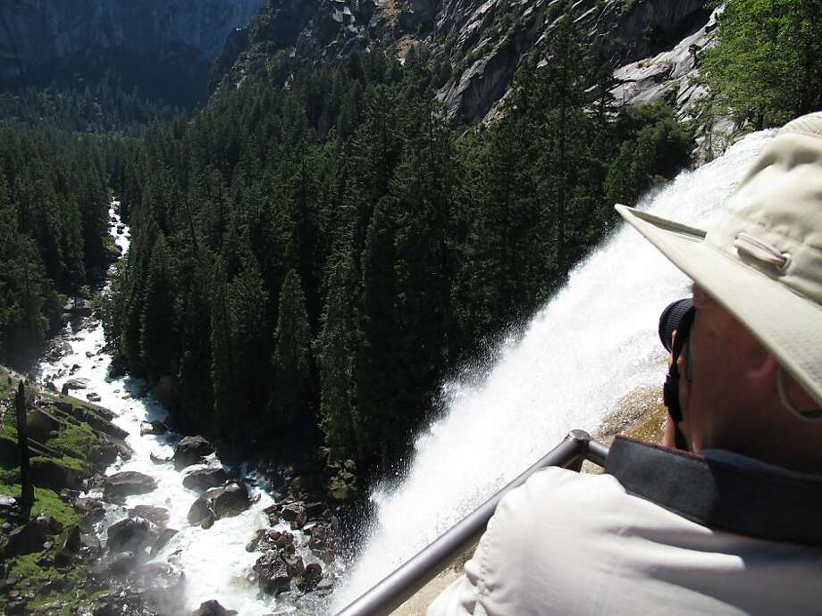 A hiker takes a photo from the top of Vernal Falls in Yosemite in 2011. Photo: Gosia Wozniacka, AP