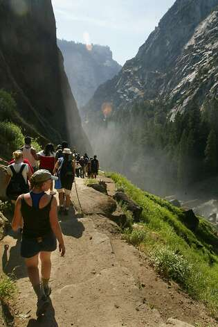 yosemite223_LM.jpg  Event on 7/21/03 in Yosemite Valley. Hikers walk down the very crowded Mist Trail next to Vernal falls in Yosemite. Story on a proposal to build new parking lot and campground in Yosemite Valley. LIZ MANGELSDORF / The Chronicle  MANDATORY CREDIT FOR PHOTOG AND SF CHRONICLE/NO SALES-MAGS OUT Photo: Liz Mangelsdorf, The Chronicle