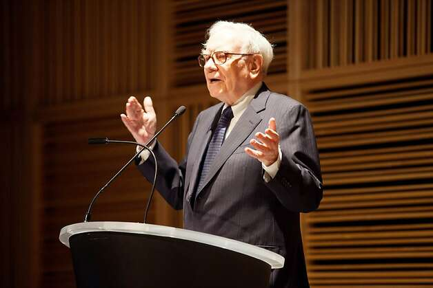 Warren Buffett,  chairman of Berkshire Hathaway, speaks on the sale of the Omaha World-Herald to Berkshire Hathaway  Wednesday Nov. 30, 2011 in Omaha Neb.  The sale is pending approval of the World-Herald's shareholders.  (AP Photo, The Omaha World-Herald, Jeff Bundy)  MAGS OUT TV OUT, LOCAL TV OUT Photo: Jeff Bundy, AP