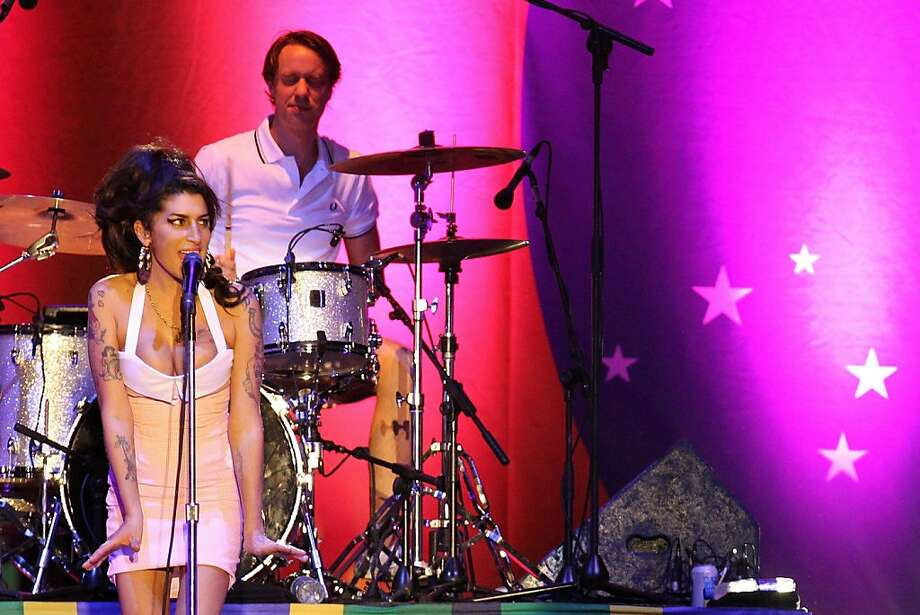 British artist Amy Winehouse, left, performs during her show in Florianopolis, Brazil, Saturday, Jan. 8, 2011. Winehouse played new material for the first time in nearly five years at her comeback show in Brazil. (AP Photo/Nabor Goulart)  Ran on: 12-04-2011 Photo caption Dummy text goes here. Dummy text goes here. Dummy text goes here. Dummy text goes here. Dummy text goes here. Dummy text goes here. Dummy text goes here. Dummy text goes here.###Photo: cds04_amy1294358400AP###Live Caption:British artist Amy Winehouse, left, performs during her show in Florianopolis, Brazil, Saturday, Jan. 8, 2011. Winehouse played new material for the first time in nearly five years at her comeback show in Brazil.###Caption History:British artist Amy Winehouse, left, performs during her show in Florianopolis, Brazil, Saturday, Jan. 8, 2011. Winehouse played new material for the first time in nearly five years at her comeback show in Brazil. (AP Photo-Nabor Goulart)###Notes:Amy Winehouse###Special Instructions: Photo: Nabor Goulart, AP