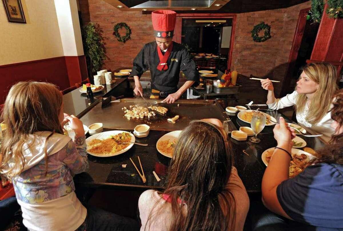 Teppanyaki chef Jason Lee cooks for a family at Sake Japanese Steakhouse on Tuesday, Nov. 29, 2011 in Latham, N.Y. (Lori Van Buren / Times Union)