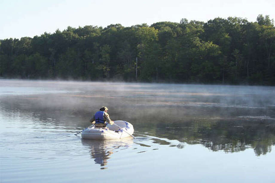 Call of the Wild: Great Barrington offers plenty of outdoor activities, like early-morning boating on Lake Mansfield. (Photo by Lee Rogers)