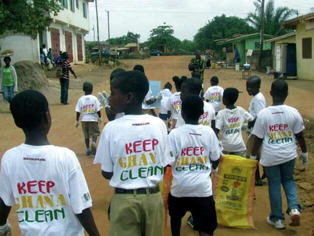 "SPECTRUM/Children from the Elf learning center move through their village on a mission to ""Keep Ghana Clean.""  2011  Courtesy of Kristin Collins Photo: Contributed Photo"